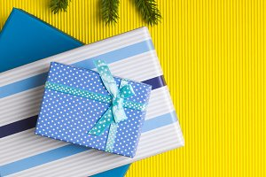 Gift boxes stack on yellow background