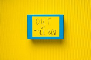 Blue box on yellow background. Out of box concept
