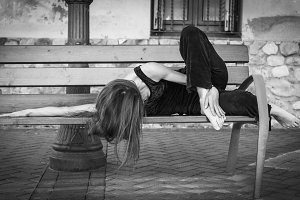 Contemporary dancer lying on a bench