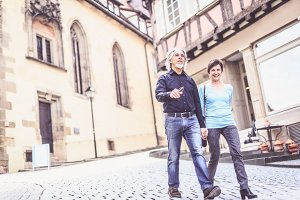 Senior Couple Walking Through The Streets Of T�bingen, Germany