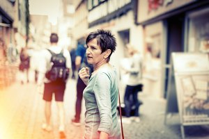 Senior Woman Walking Through The Streets Of T�bingen, Germany