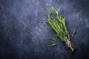 Sprigs of rosemary on black.