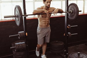 Man leaning over barbell