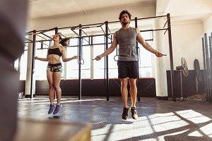 Athletes training hard at the gym