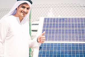 Young Arabian Man With Solar Panel