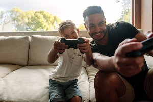 Father and son enjoying playing vide