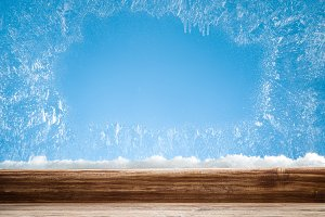 Wooden sill and frozen window.