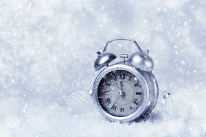 Snowy background with alarm clock