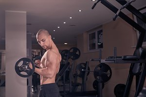 one young bodybuilder gym indoors