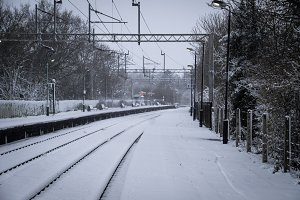 Rural rail station covered by snow