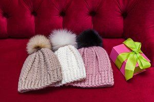 winter knitted hats with fur ball