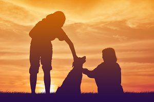 Silhouette girl with women and dog
