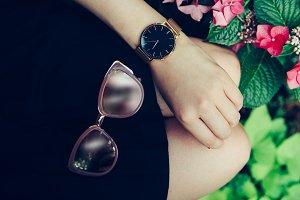 Sunglasses golden watch black skirt