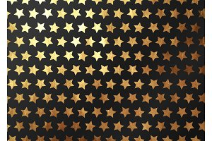 Seamless pattern vector gold stars on black background.