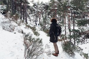 Woman standing in snowed mountain
