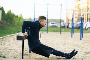 Handsome muscular young man have workout training at the park