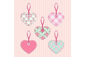 Set of vintage fabric handmade hearts with ribbon and button in shabby chic style