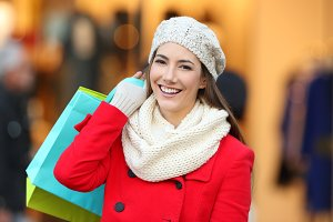 happy shopper wearing red coat