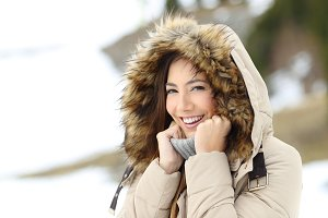 Happy woman keeping warm