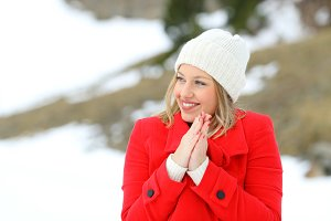 happy woman wearing a red coat