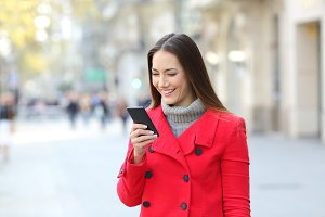 happy lady wearing a red coat