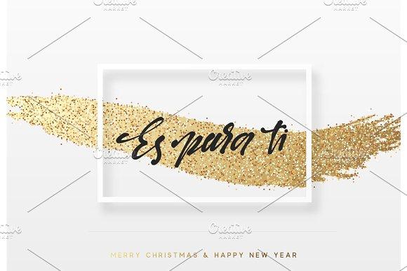 Es para ti. Feliz Navidad. Christmas background with shining gold paint brush. Xmas greeting card