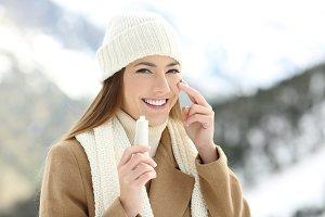 happy woman applying moisturize