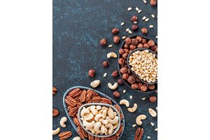 cashew, pecan, pine nuts, hazelnuts on blue