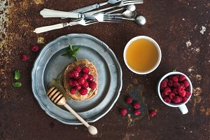 Breakfast set. Buckwheat pancakes with fresh raspberries