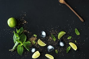 Ingredients for mojito. Fresh mint, limes, ice, sugar