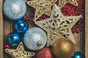 Christmas tree glittering toy stars, colorful balls and garland