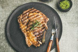 Grilled hot rib-eye beef steak with red wine, square crop