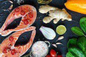 Two salmon steaks with vegetables