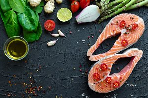 Two salmon steaks with vegetables and spices