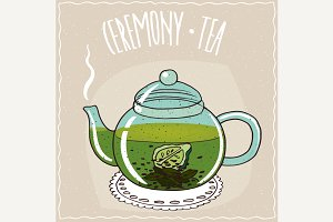 Glass teapot with tea with bergamot