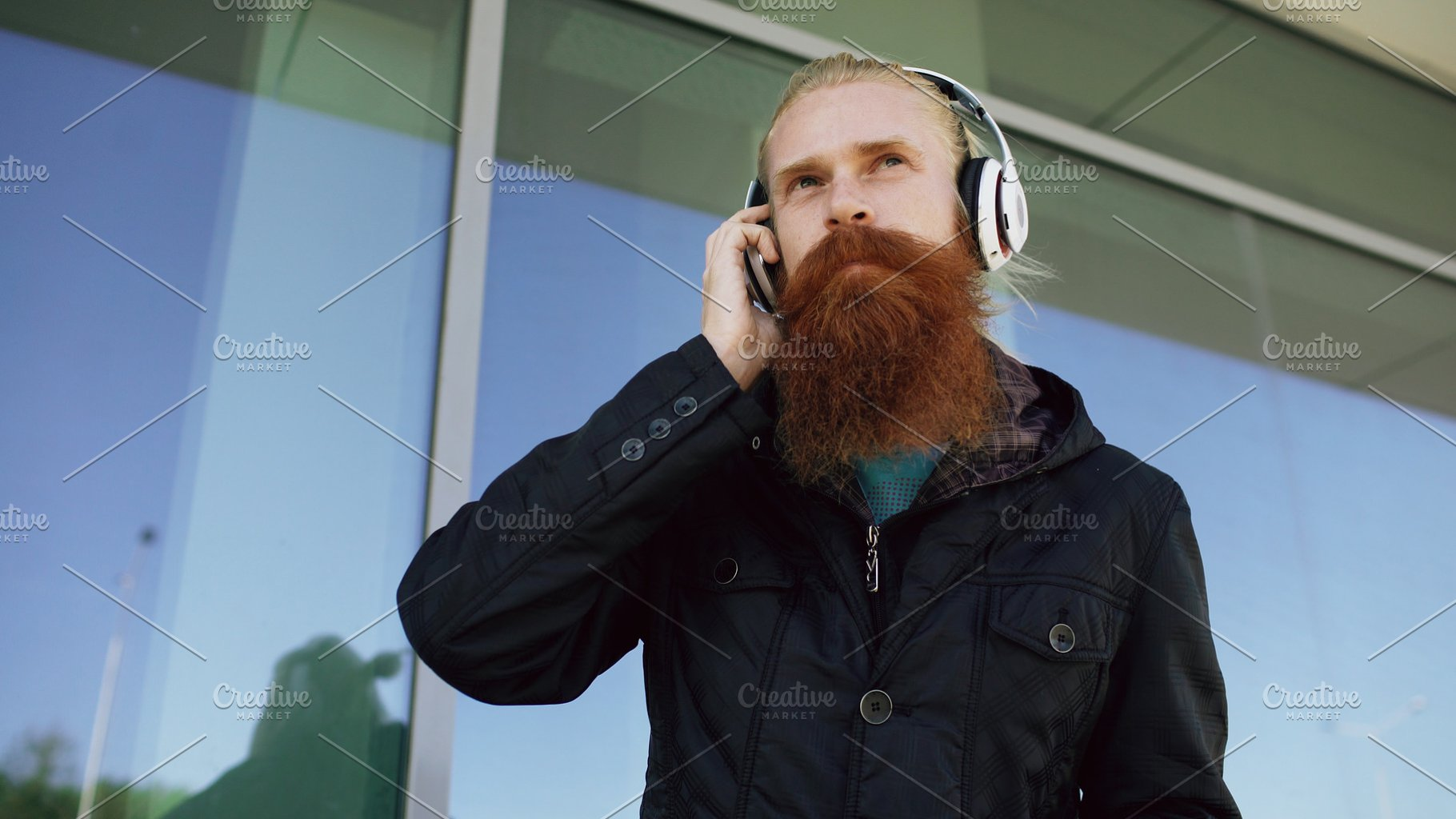 Happy Young Bearded Hipster Man With Headphones And Smartphone Listen To Music And Dancing On City Street