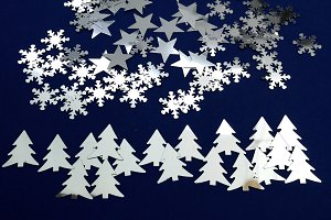 Fantasy of fir trees, stars, snow