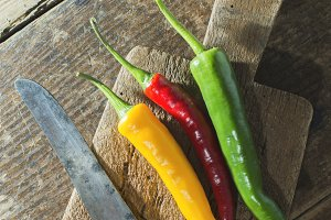 Hot peppers on wooden cutting board
