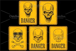 Skull on sign danger.