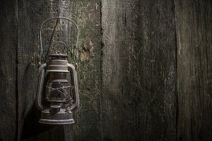 Old gas lantern on wood