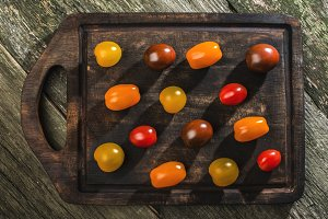 Variety of cherry tomatoes on wood