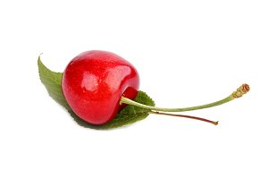 sweet cherries with the leaf isolated on a white background