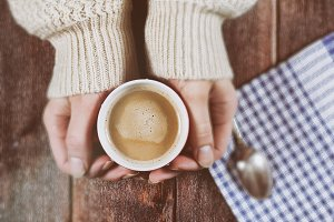 Hands with a cup of coffee latte