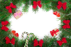 Christmas frame decorated with red bows isolated on white background with copy space for your text. Top view
