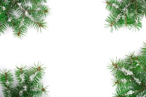 Christmas Frame of Fir tree branch with snow isolated on white background with copy space for your text. Top view