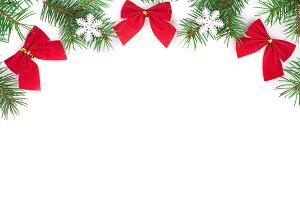 Christmas background. Frame decorated with snowflakes and red bows isolated on white with copy space for your text