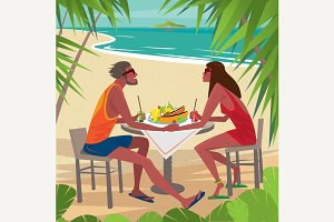 Couple eating breakfast on the beach