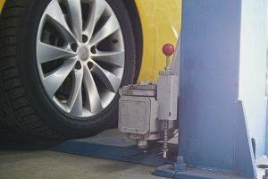 Car service work - yellow car drives to garage