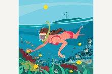 Girl snorkeling around coral reef