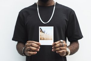 African man holding a picture (PSD)